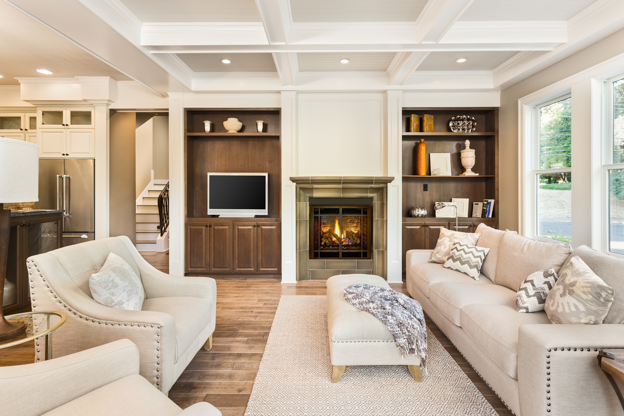 Creamy Living Room with wood built-ins